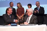 Koningin Maxima is aanwezig bij de ondertekening lening Europese Investeringsbank aan Qredits in de Hermitage, Amsterdam .<br /> <br /> Queen Maxima was present at the signing loan European Investment Bank Qredits  in the Hermitage, Amsterdam .<br /> <br /> op de foto / On the photo:  De heer Elwin Groenevelt en Drs. P. van Ballekom tekenen de overeenkomst. Koningin Máxima, Minister Kamp en Dr. Hoyer zijn op het podium getuige van de ondertekening van de EIB-lening ///// Mr. Elwin Freek and Drs. P. van Ballekom sign the agreement. Queen Máxima, Minister Kamp and Dr. Hoyer on stage witnessed the signing of the EIB loan