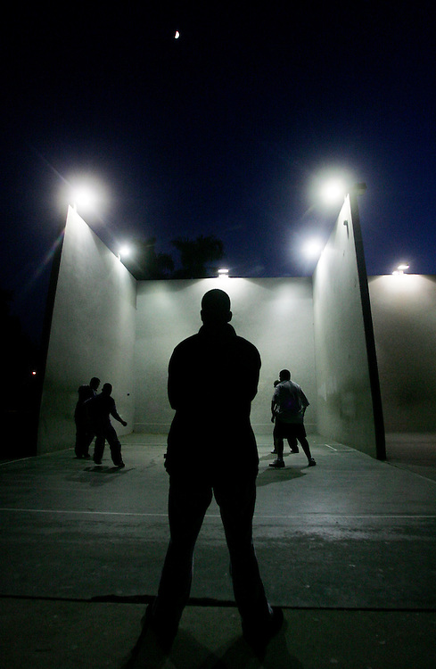 Manuel Vasquez, 15, of Orange, waits for his turn to play a game of handball during a chilly evening at El Camino Real Park in Orange Wednesday December 7, 2005.