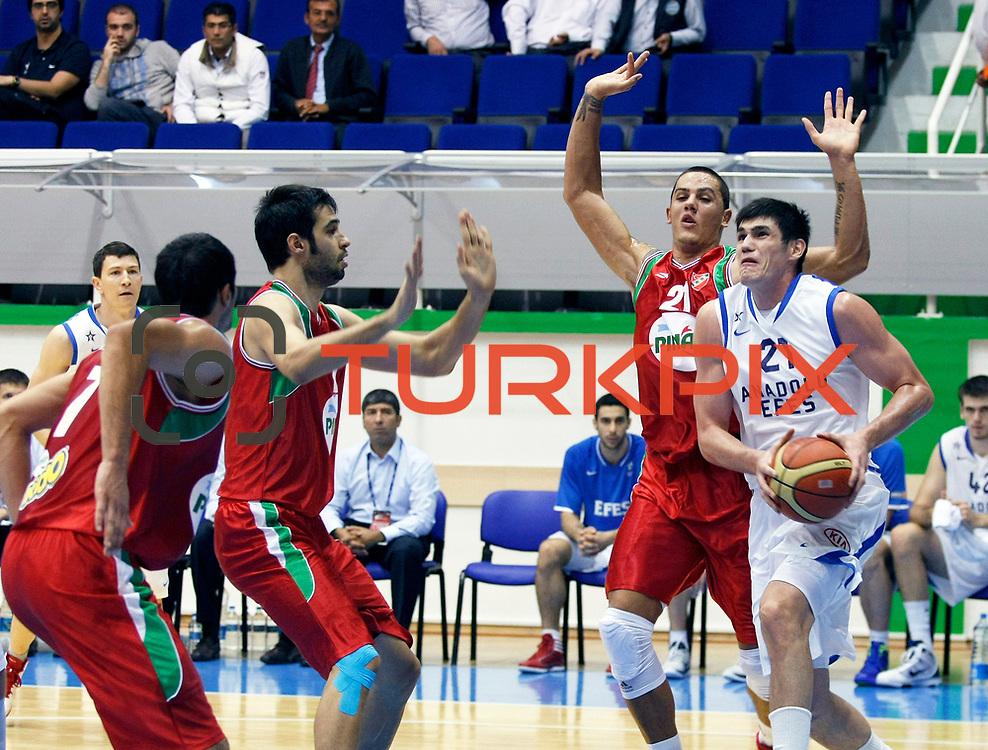 Anadolu Efes's Ersan ILYASOVA (R) during their Turkey Cup Qualifying basketball second match Anadolu Efes between Pinar Karsiyaka at Aliaga Arena in Izmir, Turkey, Monday, October 10, 2011. Photo by TURKPIX