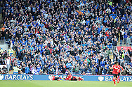 The Cardiff city fans go crazy in celebration but their delight is short-lived as Cardiff city's Juan Cala (on ground)  goal  is disallowed. Barclays Premier league match, Cardiff city  v Stoke city at the Cardiff city stadium in Cardiff, South Wales on Saturday 19th April 2014. pic by Andrew Orchard, Andrew Orchard sports photography,