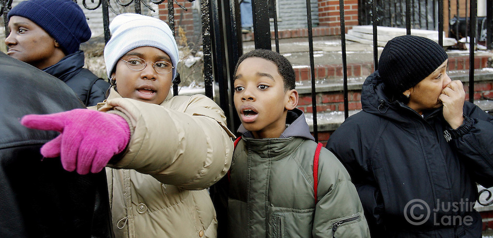Two children look at a house where 9 people were killed, 8 of them children, in an overnight fire in the Bronx, New York on Thursday 08 March 2007.