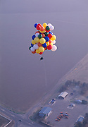 John Ninomiya empties ballast above the San Joaquin Valley near Coalinga, California.  Cutting Balloons away to descend and dumping water from containers by his side to rise, he can control his altitute and his direction of travel.