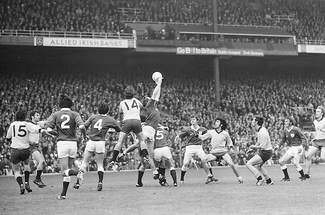 Galway player jumps high for the ball surround by a group of players during the All Ireland Senior Gaelic Football Championship Final Dublin V Galway at Croke Park on the 22nd September 1974. Dublin 0-14 Galway 1-06.