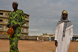 June 25, 2017 - Juba, Jubek, South Sudan - Young men arrive at the Malkei neighborhood in Juba, South Sudan to attend prayers Sunday as the Muslim world celebrates the start of Eid Al-Fitr and the end of Ramadan. Roughly half of the population of South Sudan, the world's newest nation and one now devastated by civil war, embraces Islam. (Credit Image: © Miguel Juarez Lugo via ZUMA Wire)