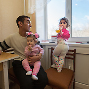 CAPTION: Arman with his two daughters, Stella and Safira. LOCATION: Volgograd, Russia. INDIVIDUAL(S) PHOTOGRAPHED: Arman Aharonyan (left), Stella Aharonyan (below) and Safira Aharonyan (right).