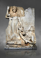 Roman Sebasteion relief  sculpture of the goddess Roma and Ge (Earth),  Aphrodisias Museum, Aphrodisias, Turkey.  Against a grey background. <br /> <br /> The goddess Roma holds a spear and wears a crown in the form of a city wall. Earth reclines half naked leaning on a pile of fruit. She holds a cornucopia full of more fruit. A baby child (now damaged) climbs up the horn she holds. The relief represents Earths fertility and abundance overseen by Rome. .<br /> <br /> If you prefer to buy from our ALAMY STOCK LIBRARY page at https://www.alamy.com/portfolio/paul-williams-funkystock/greco-roman-sculptures.html . Type -    Aphrodisias     - into LOWER SEARCH WITHIN GALLERY box - Refine search by adding a subject, place, background colour, museum etc.<br /> <br /> Visit our ROMAN WORLD PHOTO COLLECTIONS for more photos to download or buy as wall art prints https://funkystock.photoshelter.com/gallery-collection/The-Romans-Art-Artefacts-Antiquities-Historic-Sites-Pictures-Images/C0000r2uLJJo9_s0
