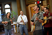 The Moss Piglets, including Ian Gamble '90, John Goolsby '90, and George Payne '92, perform in the Stewart Library during Alumni Reunion 2012.