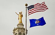 "MADISON, WI – DECEMBER 19: The ""Wisconsin"" statue sits atop the Wisconsin State Capitol on Monday, December 19, 2016. At Noon, Wisconsin Presidential electors met in the Capitol building to cast their ten electoral votes for Donald J. Trump."