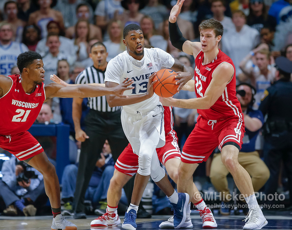 CINCINNATI, OH - NOVEMBER 13: Naji Marshall #13 of the Xavier Musketeers looks to pass the ball off during the game against the Wisconsin Badgers at Cintas Center on November 13, 2018 in Cincinnati, Ohio. (Photo by Michael Hickey/Getty Images) *** Local Caption *** Naji Marshall