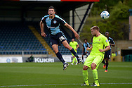 Luke O'Nien of Wycombe Wanderers heads the ball. Skybet football league two match, Wycombe Wanderers v Hartlepool Utd at Adams Park in High Wycombe, Bucks on Saturday 5th Sept 2015.<br /> pic by John Patrick Fletcher, Andrew Orchard sports photography.