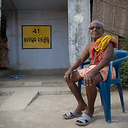 R&R - Purusottam Banchor (81) next to his house in the new resettlement colony at Jharsuguda. The house is one of the benefits as per Orissa R&R policy 2006, initiated by UNDP