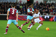 Alex Song of West Ham Utd ©  challenges  Andre Ayew of Swansea city (r).Barclays Premier league match, Swansea city v West Ham Utd at the Liberty Stadium in Swansea, South Wales  on Sunday 20th December 2015.<br /> pic by  Andrew Orchard, Andrew Orchard sports photography.