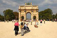 Tourists one in a wheelchair in the Jardin des Tuileries -Arch - Paris - France .<br /> <br /> Visit our FRANCE HISTORIC PLACES PHOTO COLLECTIONS for more photos to download or buy as wall art prints https://funkystock.photoshelter.com/gallery-collection/Pictures-Images-of-France-Photos-of-French-Historic-Landmark-Sites/C0000pDRcOaIqj8E