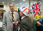 © Licensed to London News Pictures. 26/09/2014. Doncaster, UK. Richard Crowder, Chair of Bath and North Somerset is asked to remove his hat by a member of the press office.  The UKIP conference at Doncaster Racecourse Friday 26th September 2014. Photo credit : Stephen Simpson/LNP
