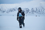 UNIS student Kiya Riverman stands in Adventdalen, Svalbard during a snowmobile driving course, part of the university center's basic safety training.