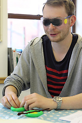 Staff wearing simulation goggles at consultation over rebranding of charity NRSB to Mysight.