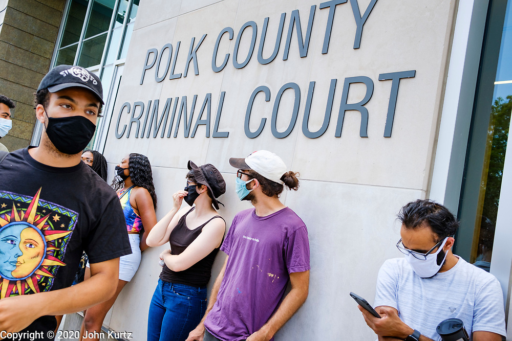 10 JULY 2020 - DES MOINES, IOWA: MATTHEW BRUCE, left, a leader of Des Moines' Black Lives Matter, leads a protest in front of the Polk County Criminal Court. About 75 people, members and supporters of Black Lives Matter gathered at the Polk County Courthouse to protest law enforcement harassment of Black Lives Matter. They also showed support for several members of BLM who made their first appearance in court following their arrest at a BLM protest last week. BLM has become very active in Des Moines in the wake of the police killing of George Floyd in Minneapolis in May.     PHOTO BY JACK KURTZ