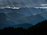 crepuscular rays on mountains digital painting based on a photograph made in the Tahoma state forest in the Cascade Range of WA