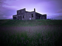 Abandoned garage on the Saskatchewan prairie, late afternoon in early summer