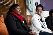 Qiana Holmes Abanukam, left, speaks during their book club meeting in Sun Prairie, Wisconsin, Friday, Oct. 26, 2018.