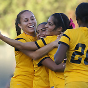 After scoring a goal, Cal St. Long Beach forwards celebrate together.