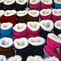 Europe, Scandinavia, Finland, Helsinki. Winter booties in a variety of colors for sale in the Helsinki market.