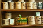 Conserve tins cans with different kinds of duck specialities Cassoulet de Bergerac, Coq au vin, Salmis de Pintade, Duck Fat, Foie Gras, Quail... Ferme de Biorne duck and fowl farm Dordogne France Workshop on how to make foie gras duck liver pate and other conserves