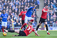 Barnsley Midfielder, Cameron McGeehan (8) slide tackles Portsmouth Midfielder, Ronan Curtis (11) during the EFL Sky Bet League 1 match between Portsmouth and Barnsley at Fratton Park, Portsmouth, England on 23 February 2019.