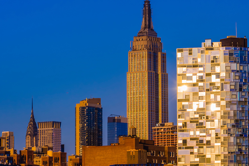 Chryslter Building, Empire State Building and glass residential tower at 100 11th Avenue (with 1647 different window panes), New York City, New York, USA.