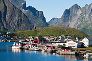 Steep mountains surround the fishing village of Reine on Moskenesøya (the Moskenes Island), in the Lofoten archipelago, Nordland county, Norway.