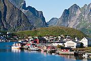 Steep mountains surround the fishing village of Reine on Moskenesøya (the Moskenes Island), in the Lofoten archipelago, Nordland county, Norway.