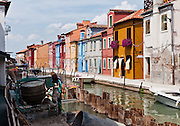 "Burano, known for knitted lacework, fishing, and colorfully painted houses, is a small archipelago of four islands linked by bridges in the Venetian Lagoon, northern Italy, Europe. Burano's traditional house colors are strictly regulated by government. The Romans may have been first to settle Burano. Romantic Venice (Venezia), ""City of Canals,"" stretches across 117 small islands in the marshy Venetian Lagoon along the Adriatic Sea in northeast Italy, between the mouths of the Po (south) and Piave (north) Rivers. Venice and the Venetian Lagoon are honored on UNESCO's World Heritage List."
