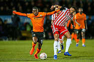 Barnet midfielder Wesley Fonguck (18) tussles with Brentford defender Julian Jeanvier (23) during the The FA Cup fourth round match between Barnet and Brentford at The Hive Stadium, London, England on 28 January 2019.