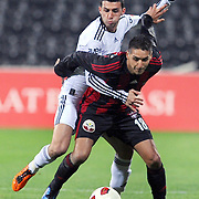Besiktas's Ismail KOYBASI (L) and Gaziantepspor's Ismael SOSA (R) during their Turkey Cup semi final soccer firsth match Besiktas between Gaziantepspor at the Inonu stadium in Istanbul Turkey on Wednesday 06 April 2011. Photo by TURKPIX