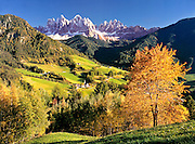 The tiny Dolomite village of Santa Magdalena nestles beneath the Odle Group near Bolzano, Italy.