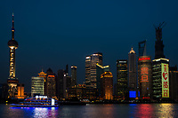 Shanghai, China - April 10, 2013: pudong waterfront at sunset at the city of Shanghai in China on april 10 th, 2013