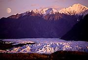 Alaska. Matanuska Glacier. Moonrise over Chugach Mts with alpenglow on peaks and ice.