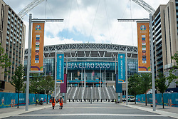 © Licensed to London News Pictures. 10/06/2021. LONDON, UK.  Workmen installing signage around Wembley Stadium for the upcoming 2020 UEFA European Football Championship, commonly known as Euro 2020.  The tournament was postponed from 2020 due to the COVID-19 pandemic in Europe and rescheduled for 11 June to 11 July 2021 with matches to be played in 11 cities in 11 UEFA countries.  Wembley Stadium will host certain group matches including England v Croatia on 13 June, as well as the semi-finals and final itself.  Photo credit: Stephen Chung/LNP