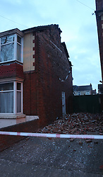 Portsmouth Hampshire Monday 28th March 2016  Storm Katie hit the South Coast with wind speed recorded of over 109 mph.  Overnight, there was some disruption and a lot of wind damage has been reported due to winds of up to 106 mph recorded on Needles on the Isle of Wight<br /> <br /> This  Portsmouth Street is cordoned off after the gable end collapsed on the property  just after 2am  Two fire crews from Southsea fire station in Portsmouth attended and made safe a roof in a dangerous condition in Copnor