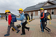 Some first year elementary school students get ready to leave at the end of the day. Kawauchi Elementary School, Kawauchi, Fukushima, Japan. Tuesday April 30th 2013. Kawauchi was evacuated after the accidents at Fukushima Daichi nuclear plant but has been nominally decontaminated and some of the school children have returned to classes.