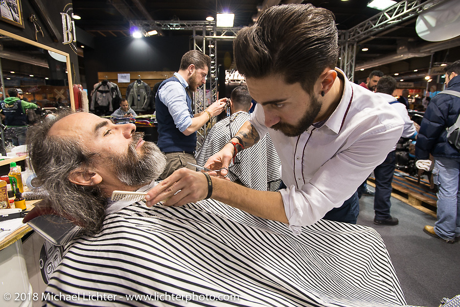Barber as artiste at the Motor Bike Expo. Verona, Italy. January 22, 2016.  Photography ©2016 Michael Lichter.