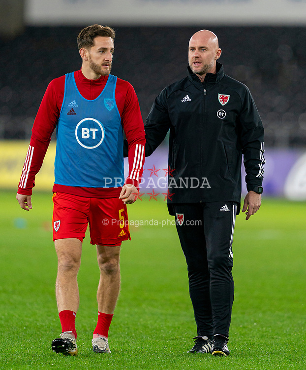 SWANSEA, WALES - Thursday, November 12, 2020: Wales' assistant coach Robert Page, who stands in for manager Ryan Giggs after he was arrested on suspicion of assault, with Tom Lockyer during the pre-match warm-up before an International Friendly match between Wales and the USA at the Liberty Stadium. (Pic by David Rawcliffe/Propaganda)