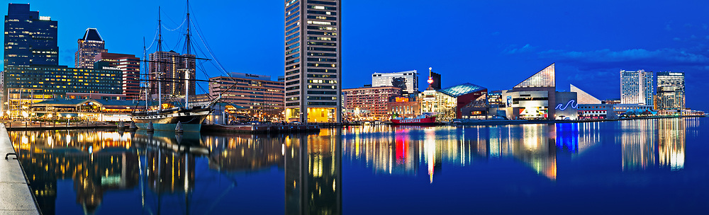 The Baltimore Inner Harbor is seen after the sun has set and dusk is settling in.