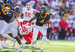 Sep 4, 2021; College Park, Maryland, USA; West Virginia Mountaineers running back Leddie Brown (4) runs for a touchdown during the second quarter against the Maryland Terrapins at Capital One Field at Maryland Stadium. Mandatory Credit: Ben Queen-USA TODAY Sports