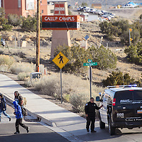 032415       Cable Hoover<br /> <br /> A Gallup Police Community Service Aide turns students away from the UNM-Gallup campus Tuesday. Police had the school locked down following a bomb threat.