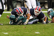PHILADELPHIA - DECEMBER 30: Quarteback Donovan McNabb #5 of the Philadelphia Eagles is sacked by John Digiorgio #52 of the Bills during the game against the Buffalo Bills on December 30, 2007 at Lincoln Financial Field in Philadelphia, Pennsylvania. The Eagles won 17-9.