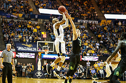 Jan 9, 2018; Morgantown, WV, USA; West Virginia Mountaineers guard Jevon Carter (2) shoots a three pointer late in the second half against the Baylor Bears at WVU Coliseum. Mandatory Credit: Ben Queen-USA TODAY Sports
