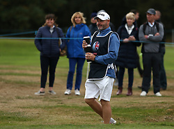 Lee Westwood's caddie come backs with hot drinks during day two of the British Masters at Walton Heath Golf Club, Surrey.