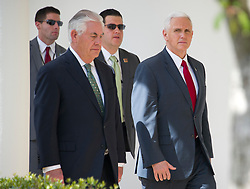 United States Secretary of State Rex Tillerson, left, and US Vice President Mike Pence walk on the colonnade to the Residence after US President Donald J. Trump and King Abdullah II of conducted a joint press conference in the Rose Garden of the White House in Washington, DC on Wednesday, April 5, 2017.<br /> Credit: Ron Sachs / CNP *** Please Use Credit from Credit Field ***