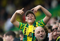 A young Norwich City fan in the stands during the Premier League match at Carrow Road, Norwich. Picture date: Saturday October 16, 2021.